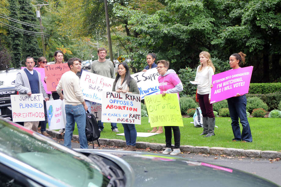 Members of the Yale Student Health and Aids Coalition and Planned Parenthood Voted Connecticut gather to protest outside Woodway Country Club where Vice President candidate Paul Ryan's joined supporters for an event on Hoyt Street in Darien, Conn., Saturday, Sept. 30, 2012. Photo: Keelin Daly / Stamford Advocate