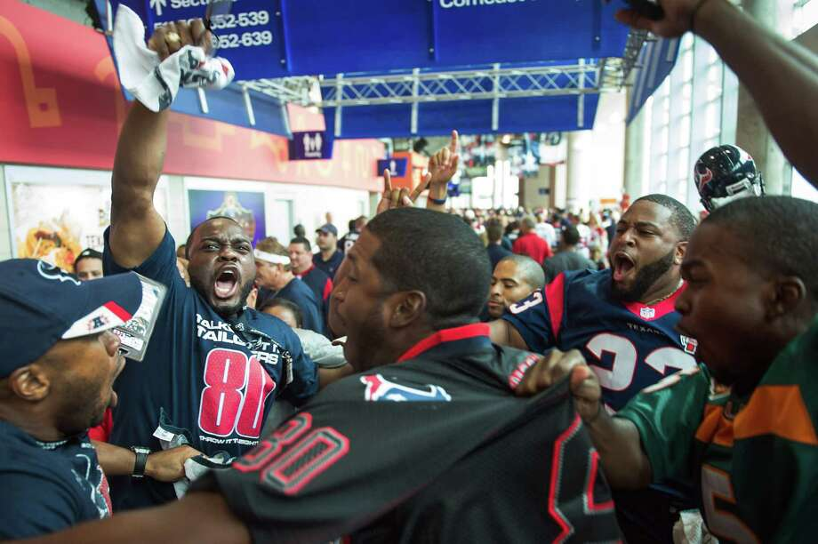Houston Texans fans get pumped up on the upper concourse before their team faces the Tennessee Titans at Reliant Stadium on Sunday, Sept. 30, 2012, in Houston. Photo: Smiley N. Pool, Houston Chronicle / © 2012  Houston Chronicle