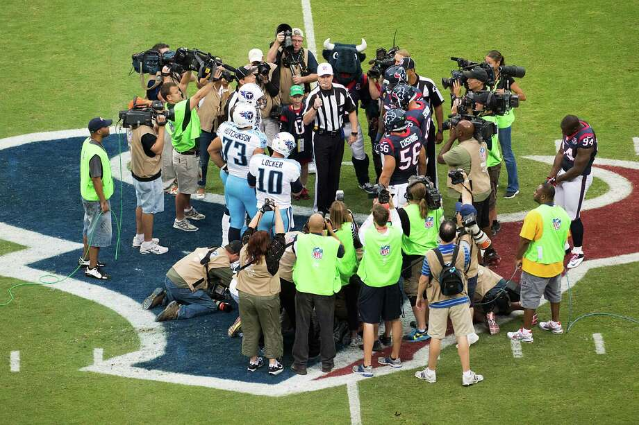 The opening coin toss gets plenty of media attention before the Houston Texans face the Tennessee Titans at Reliant Stadium on Sunday, Sept. 30, 2012, in Houston. Photo: Smiley N. Pool, Houston Chronicle / © 2012  Houston Chronicle
