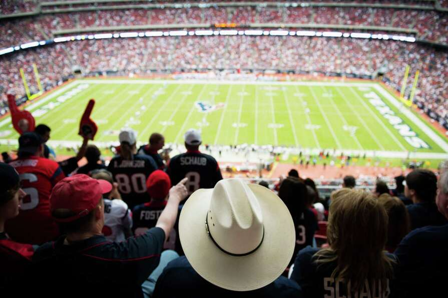 Fans cheer the opening kickoff as the Houston Texans face the Tennessee Titans at Reliant Stadium on