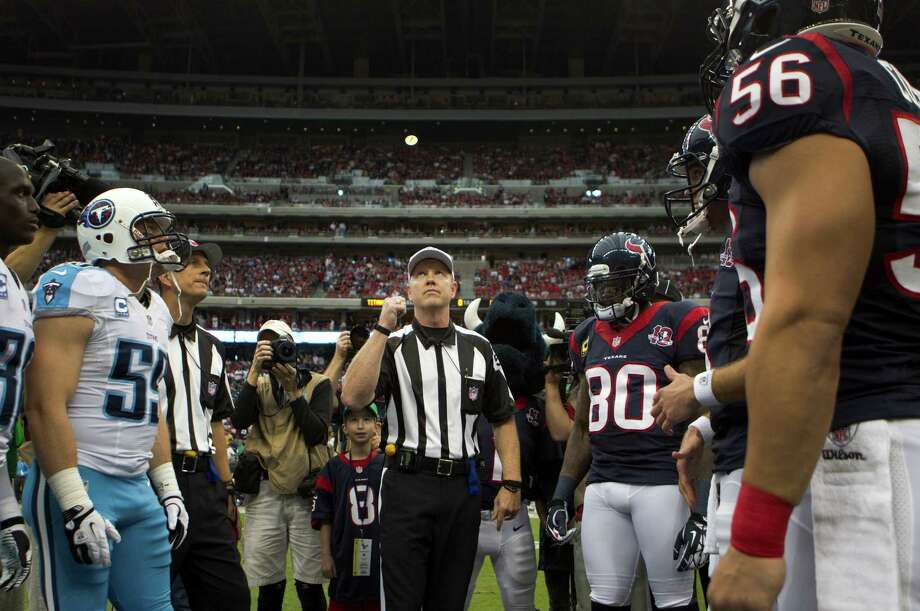 Referee Ken Roan performs the pregame coin toss before the Houston Texans faced the Tennessee Titans at Reliant Stadium on Sunday, Sept. 30, 2012, in Houston. Photo: Brett Coomer, Houston Chronicle / © 2012  Houston Chronicle