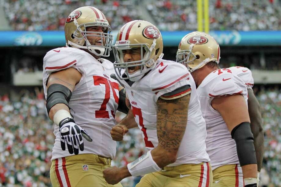 San Francisco 49ers quarterback Colin Kaepernick (7) celebrates after scoring a touchdown with teammates  Alex Boone (75) and  Joe Staley (74) during the first half of an NFL football game against the New York Jets Sunday, Sept. 30, 2012, in East Rutherford, N.J. (AP Photo/Kathy Willens) Photo: Kathy Willens / AP