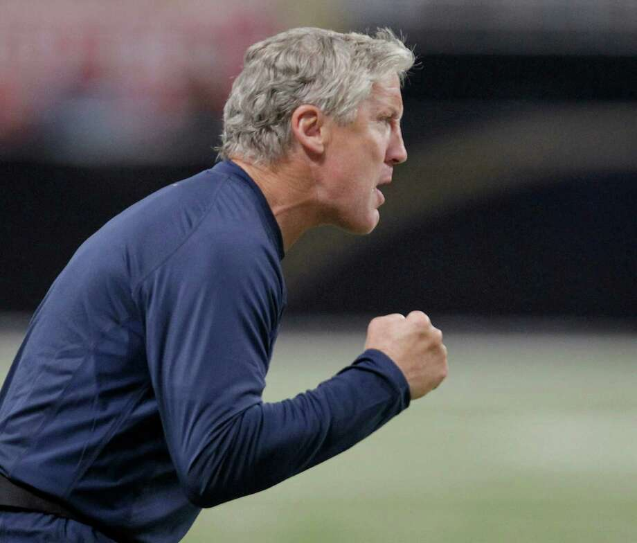 Seattle Seahawks head coach Pete Carroll encourages his team during the second half of an NFL football game against the St. Louis Rams Sunday, Sept. 30, 2012, in St. Louis. Photo: AP