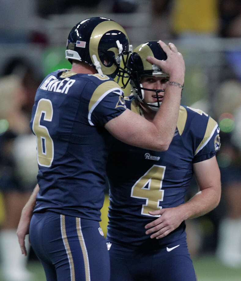 St. Louis Rams kicker Greg Zuerlein (4) is congratulated by  Johnny Hekker after kicking a 60-yard field goal during the second half of an NFL football game against the Seattle Seahawks Sunday, Sept. 30, 2012, in St. Louis. The Rams defeated the Seahawks, 19-13. Photo: AP