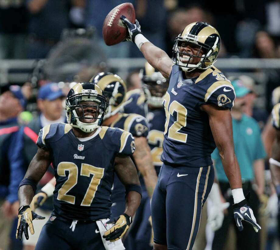 St. Louis Rams cornerback Bradley Fletcher (32) and teammate Quintin Mikell (27) smile after Fletcher intercepted a pass late in the fourth quarter of an NFL football game against the Seattle Seahawks on Sunday, Sept. 30, 2012, in St. Louis. The Rams defeated the Seahawks 19-13. Photo: AP