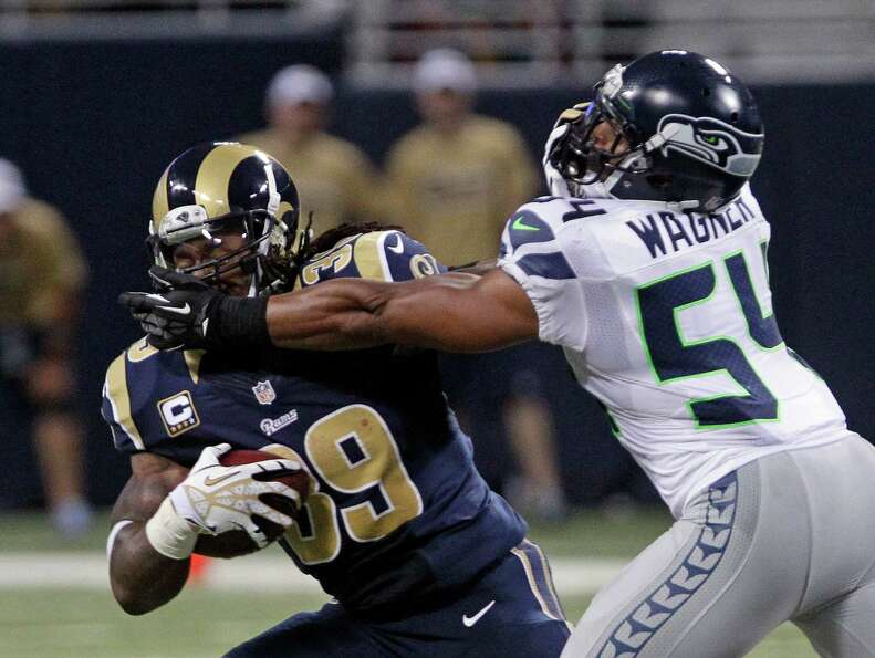 St. Louis Rams running back Steven Jackson is tackled by Seattle Seahawks middle linebacker Bobby Wa