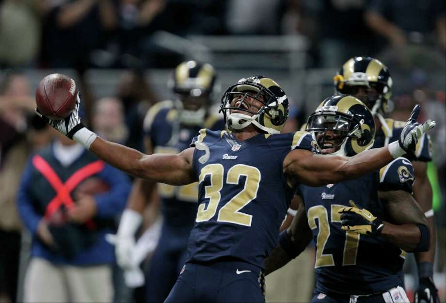 St. Louis Rams cornerback Bradley Fletcher (32) reacts with  Quintin Mikell (27) after intercepting a pass late in the fourth quarter of an NFL football game against the Seattle Seahawks Sunday, Sept. 30, 2012, in St. Louis. The Rams defeated the Seahawks, 19-13. Photo: AP