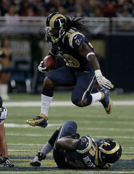 St. Louis Rams running back Steven Jackson (39) leaps over a teammate during the second half of an N
