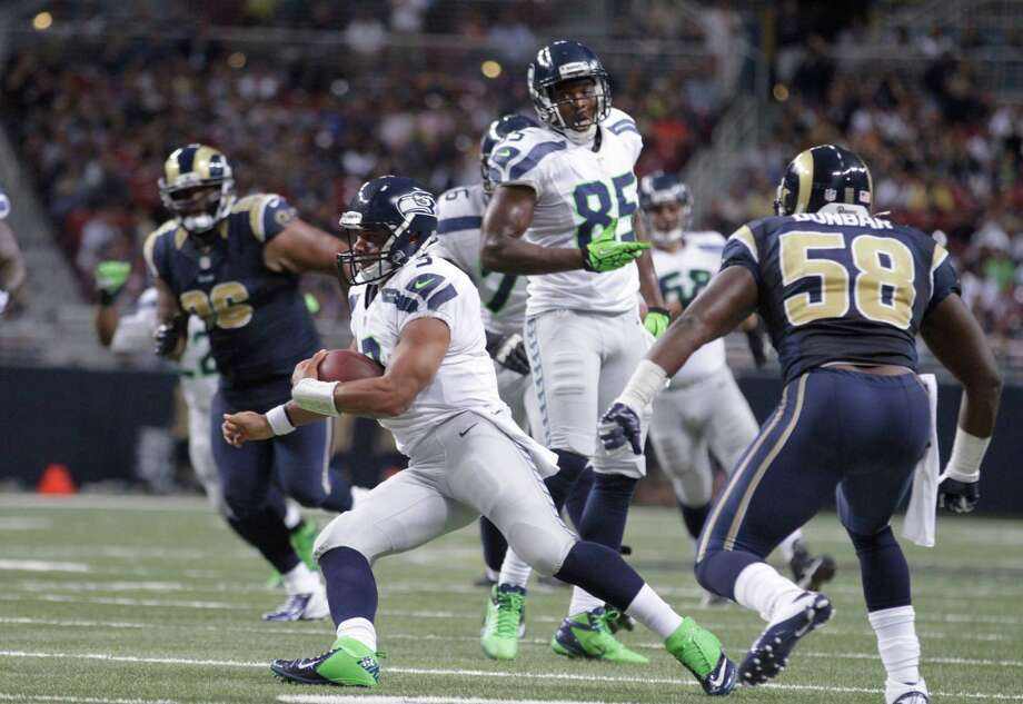 Seattle Seahawks quarterback Russell Wilson (3) runs during the second half of an NFL football game against the St. Louis Rams Sunday, Sept. 30, 2012, in St. Louis. Photo: AP