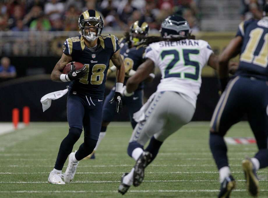St. Louis Rams wide receiver Austin Pettis (18) is defended by Seattle Seahawks' Richard Sherman (25) during the first half of an NFL football game Sunday, Sept. 30, 2012, in St. Louis. Photo: AP