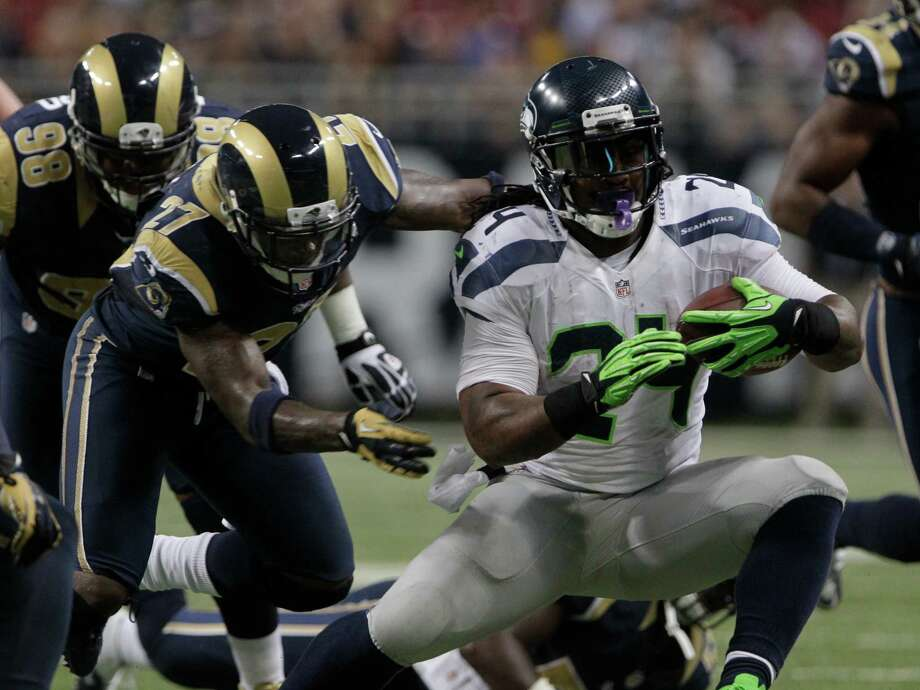 Seattle Seahawks running back Marshawn Lynch (24) is tackled by St. Louis Rams free safety Quintin Mikell (27) during the second half of an NFL football game Sunday, Sept. 30, 2012, in St. Louis. Photo: AP
