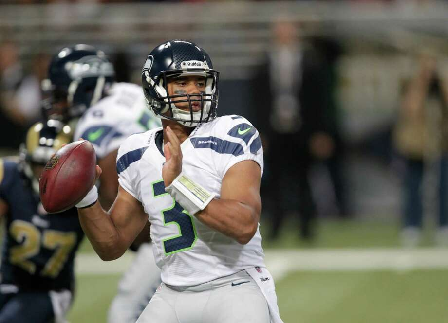 Seattle Seahawks' Russell Wilson (3) throws during the second half against the St. Louis Rams of an NFL football game Sunday, Sept. 30, 2012, in St. Louis. Photo: AP