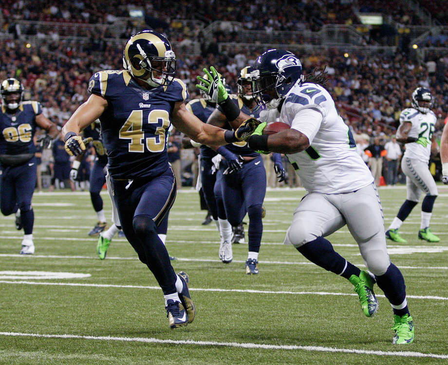 Seattle Seahawks running back Marshawn Lynch (24) runs past St. Louis Rams strong safety Craig Dahl for an 18-yard touchdown run during the first half of an NFL football game Sunday, Sept. 30, 2012, in St. Louis. Photo: AP