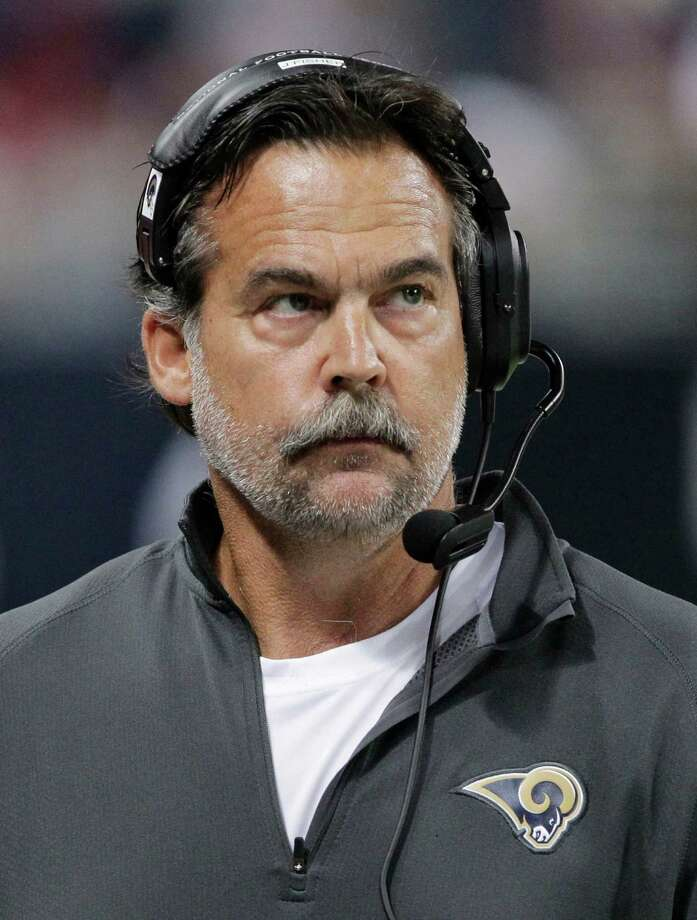 St. Louis Rams coach Jeff Fisher takes a look at the scoreboard during the second half of an NFL football game against the Seattle Seahawks on Sunday, Sept. 30, 2012, in St. Louis. The Rams won 19-13. Photo: AP