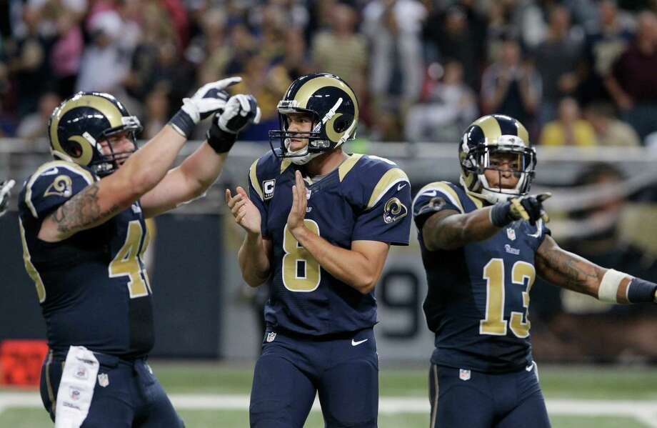 St. Louis Rams quarterback Sam Bradford (8),  Brit Miller (49) and  Chris Givens (13) react near the end of an NFL football game against the Seattle Seahawks Sunday, Sept. 30, 2012, in St. Louis. The Rams defeated the Seahawks, 19-13. Photo: AP