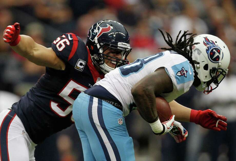 Houston Texans inside linebacker Brian Cushing (56) wraps up Tennessee Titans running back Chris Johnson (28) during the second quarter at Reliant Stadium on Sunday, Sept. 30, 2012, in Houston. Photo: Brett Coomer, Houston Chronicle / © 2012  Houston Chronicle