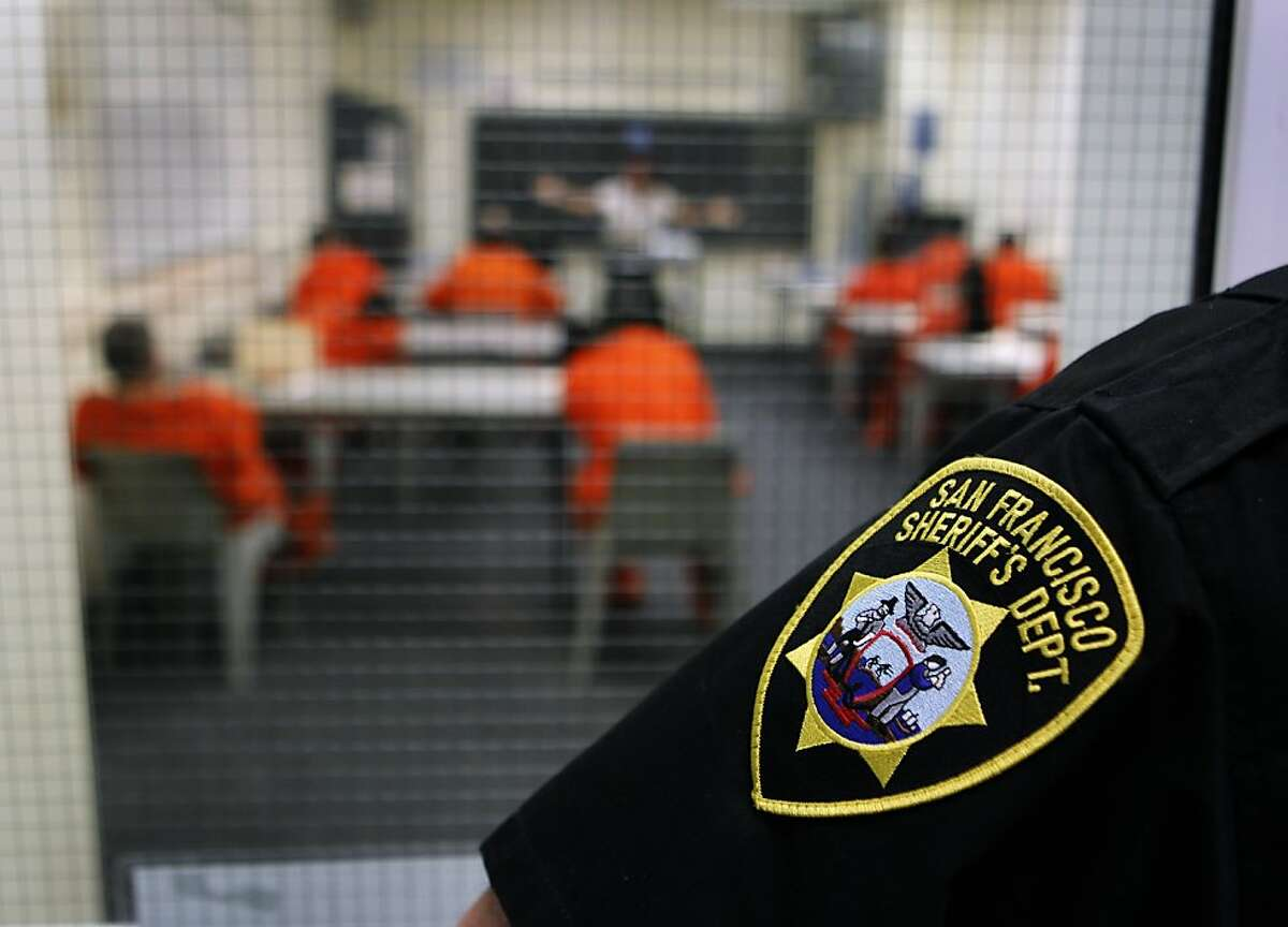 A sheriff's deputy stands in the hallway while prisoners attend classes at the San Francisco County Jail in San Bruno.