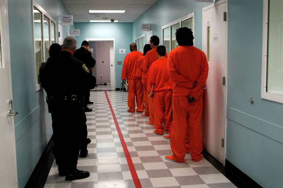 Sheriff's deputies escort prisoners back to their cells after attending classes at San Francisco County Jail No. 5 in San Bruno in 2012. Photo: Paul Chinn / The Chronicle / ONLINE_YES