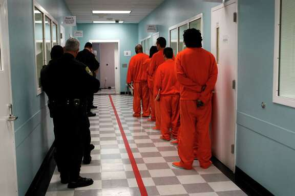 Sheriff's deputies escort prisoners back to their cells after attending classes at San Francisco County Jail No. 5 in San Bruno in 2012.