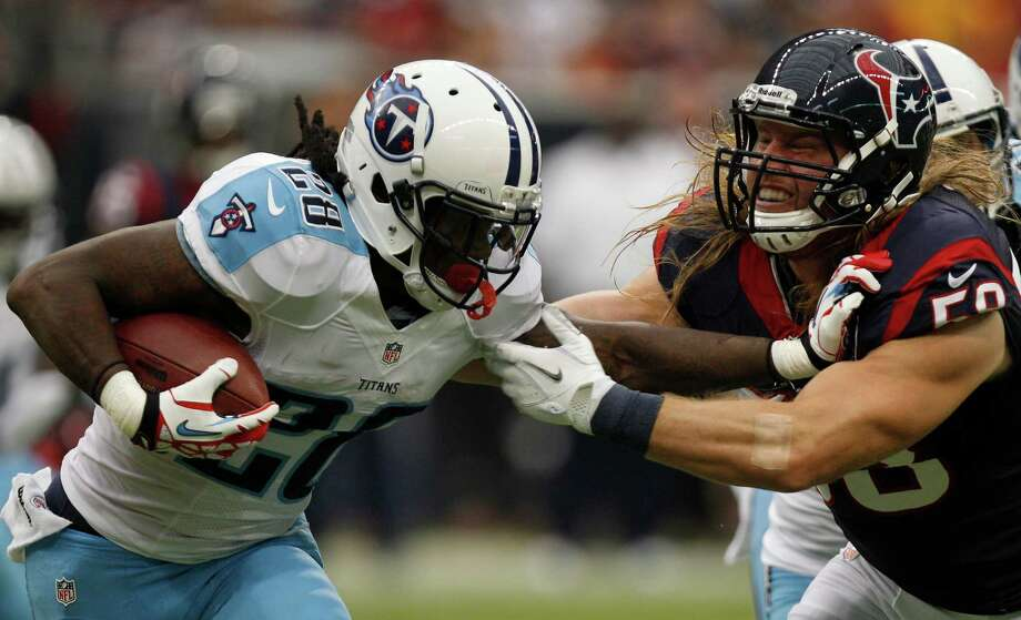 Houston Texans outside linebacker Brooks Reed (58) brings down Tennessee Titans running back Chris Johnson (28) during the second quarter at Reliant Stadium on Sunday, Sept. 30, 2012, in Houston. Photo: Brett Coomer, Houston Chronicle / © 2012  Houston Chronicle