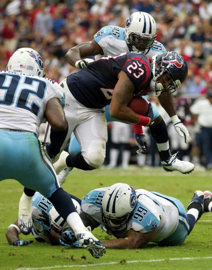Houston Texans running back Arian Foster (23) scores on a 4yard touchdown run against the Tennessee Titans during the first quarter at Reliant Stadium on Sunday, Sept. 30, 2012, in Houston. Photo: Brett Coomer, Houston Chronicle / © 2012  Houston Chronicle