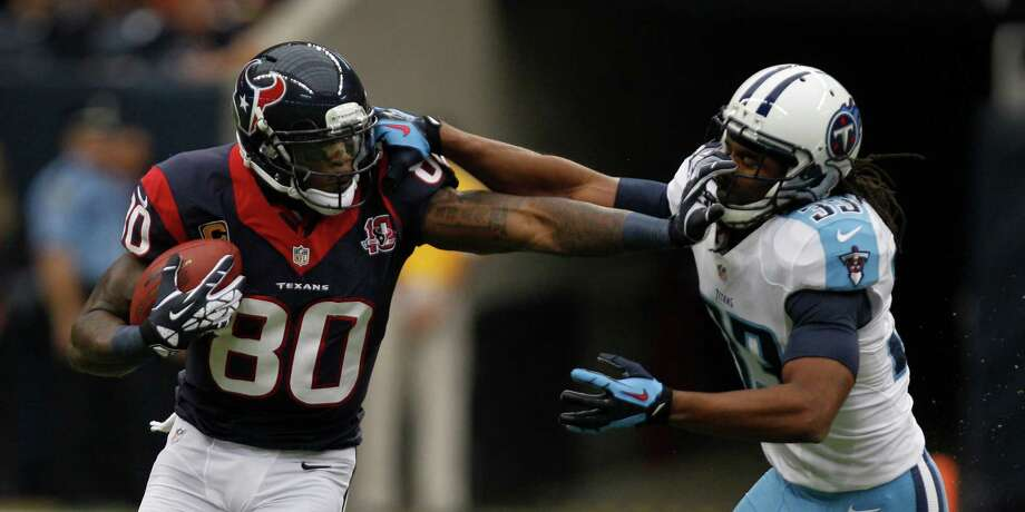 Houston's Andre Johnson (left) needs 76 receiving yards Monday night to reach 10,000 for his career. It would make him the sixth-fastest player to reach that mark. Photo: Brett Coomer, Houston Chronicle / © 2012  Houston Chronicle