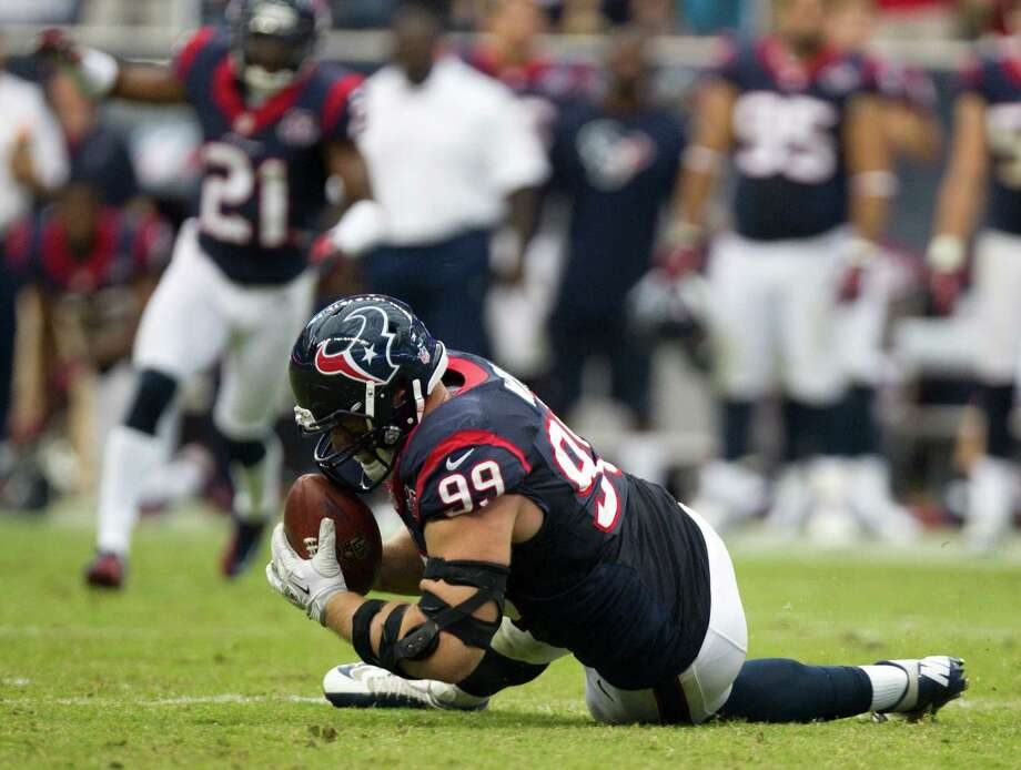 Houston Texans defensive end J.J. Watt (99) dives of a fumble by Tennessee Titans quarterback Matt Hasselbeck during the fourth quarter at Reliant Stadium on Sunday, Sept. 30, 2012, in Houston. The Texans beat the Titans 38-14. Photo: Brett Coomer, Houston Chronicle / © 2012  Houston Chronicle