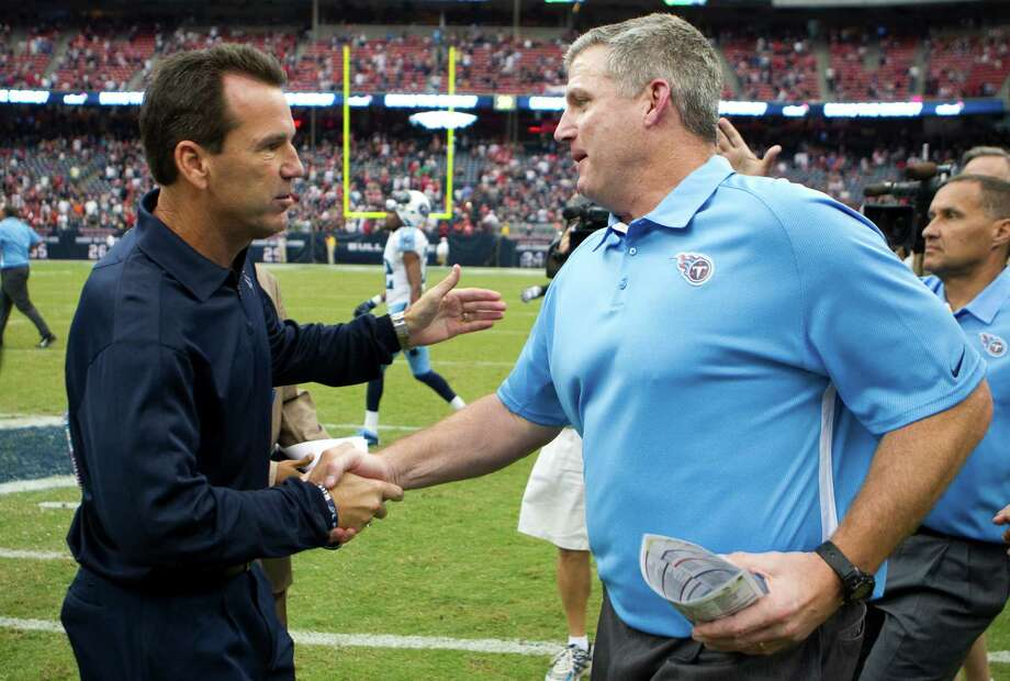 Houston Texans head coach Gary Kubiak, left, and Tennessee Titans head coach Mike Munchak shake hands after the Texans beat the Titans at Reliant Stadium on Sunday, Sept. 30, 2012, in Houston. The Texans beat the Titans 38-14. Photo: Brett Coomer, Houston Chronicle / © 2012  Houston Chronicle