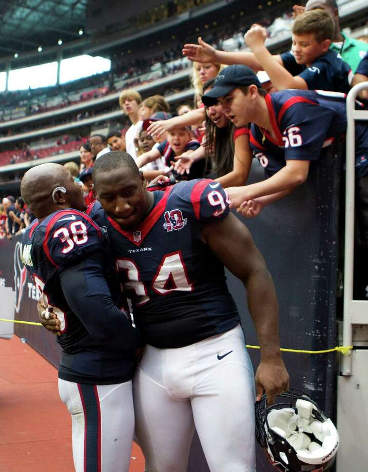 Houston Texans free safety Danieal Manning (38) and defensive end Antonio Smith (94) embrace as they leaves the field after the Texans beat the Tennessee Titans at Reliant Stadium on Sunday, Sept. 30, 2012, in Houston. The Texans beat the Titans 38-14. Photo: Brett Coomer, Houston Chronicle / © 2012  Houston Chronicle
