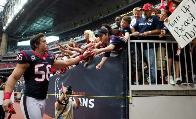 Houston Texans inside linebacker Brian Cushing (56) slaps hands with fans as he leaves the field after the Texans beat the Tennessee Titans at Reliant Stadium on Sunday, Sept. 30, 2012, in Houston. The Texans beat the Titans 38-14. Photo: Brett Coomer, Houston Chronicle / © 2012  Houston Chronicle