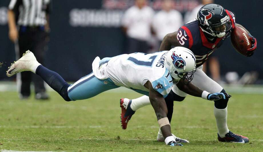 Houston Texans cornerback Kareem Jackson (25) steps in front of Tennessee Titans wide receiver Damian Williams (17) for an interception, that he returned 63 yards for a touchdown during the fourth quarter at Reliant Stadium on Sunday, Sept. 30, 2012, in Houston. The Texans beat the Titans 38-14. Photo: Brett Coomer, Houston Chronicle / © 2012  Houston Chronicle
