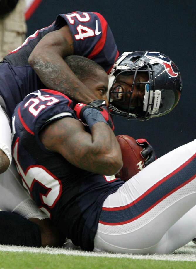 Houston Texans cornerback Johnathan Joseph (24) embraces cornerback Kareem Jackson (25) celebrating Jackson's 63-yard interception return for a touchdown against the Tennessee Titans during the fourth quarter at Reliant Stadium on Sunday, Sept. 30, 2012, in Houston. The Texans beat the Titans 38-14. Photo: Brett Coomer, Houston Chronicle / © 2012  Houston Chronicle