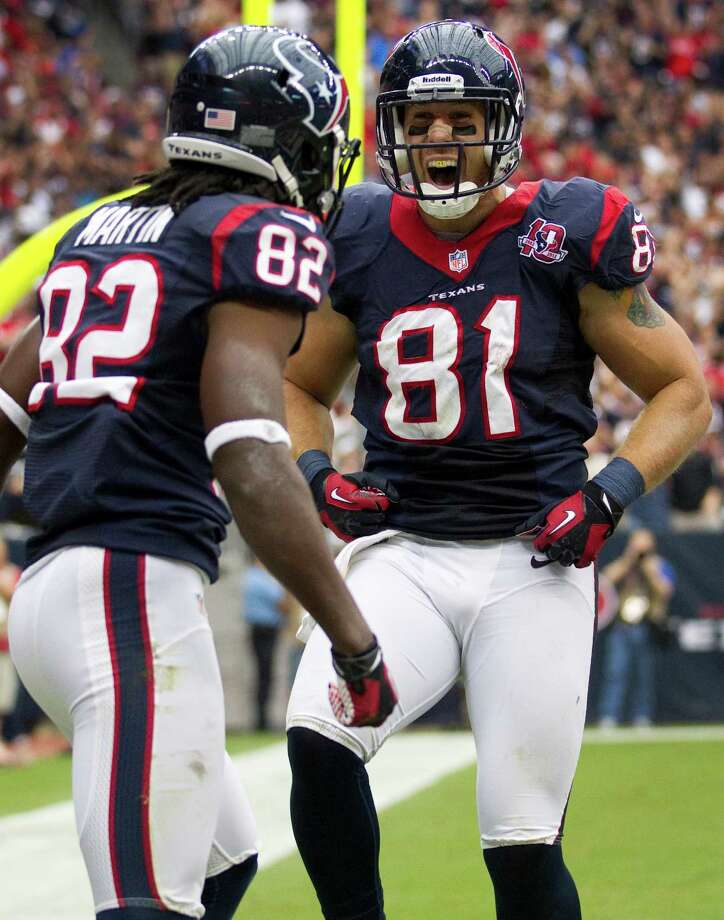 Houston Texans tight end Owen Daniels (81) and wide receiver Keshawn Martin (82) celebrate Daniels' 28-yard touchdown reception against the Tennessee Titans during the third quarter at Reliant Stadium on Sunday, Sept. 30, 2012, in Houston. The Texans beat the Titans 38-14. Photo: Brett Coomer, Houston Chronicle / © 2012  Houston Chronicle