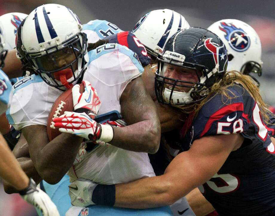 Tennessee Titans running back Chris Johnson (28) is stopped by Houston Texans outside linebacker Brooks Reed (58) during the third quarter at Reliant Stadium on Sunday, Sept. 30, 2012, in Houston. The Texans beat the Titans 38-14. Photo: Brett Coomer, Houston Chronicle / © 2012  Houston Chronicle