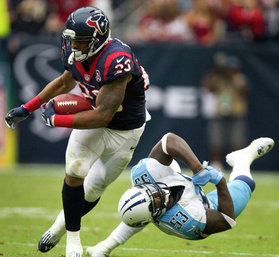 Houston Texans running back Arian Foster (23) cuts back across the field, breaking away from a missed tackle by Tennessee Titans linebacker Zac Diles (53) during the third quarter at Reliant Stadium on Sunday, Sept. 30, 2012, in Houston. The Texans beat the Titans 38-14. Photo: Brett Coomer, Houston Chronicle / © 2012  Houston Chronicle