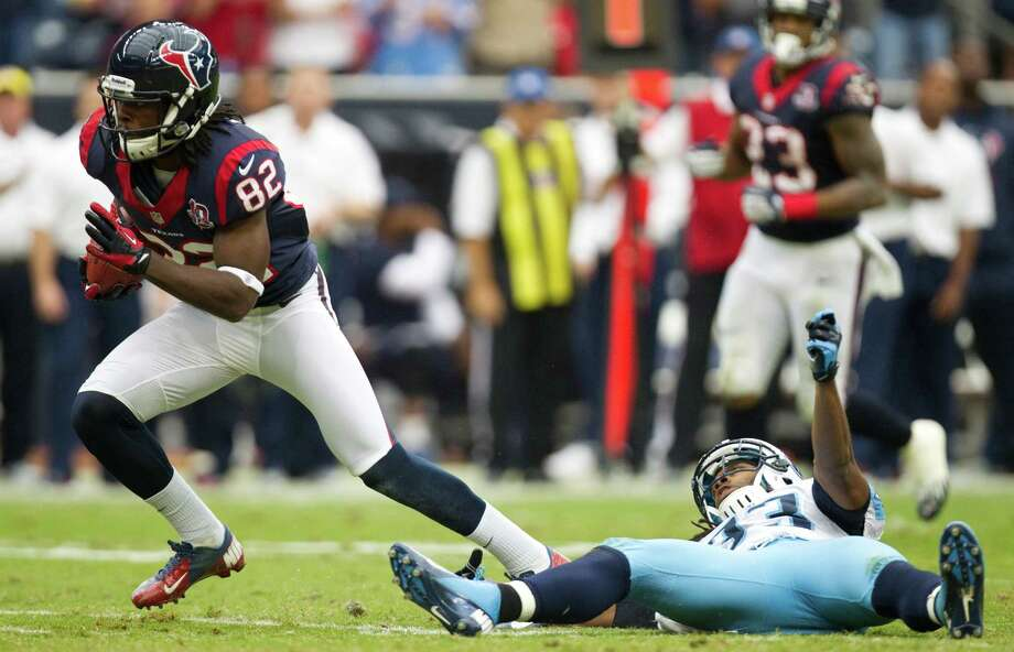 Houston Texans wide receiver Keshawn Martin (82) breaks away from Tennessee Titans free safety Michael Griffin (33) during the third quarter at Reliant Stadium on Sunday, Sept. 30, 2012, in Houston. The Texans beat the Titans 38-14. Photo: Brett Coomer, Houston Chronicle / © 2012  Houston Chronicle