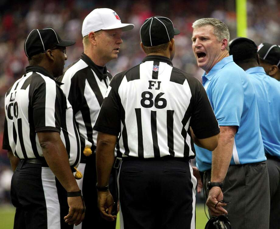 Tennessee Titans head coach Mike Munchak, right, argues a call with the officials during the third quarter against the Tennessee Titans at Reliant Stadium on Sunday, Sept. 30, 2012, in Houston. Photo: Brett Coomer, Houston Chronicle / © 2012  Houston Chronicle