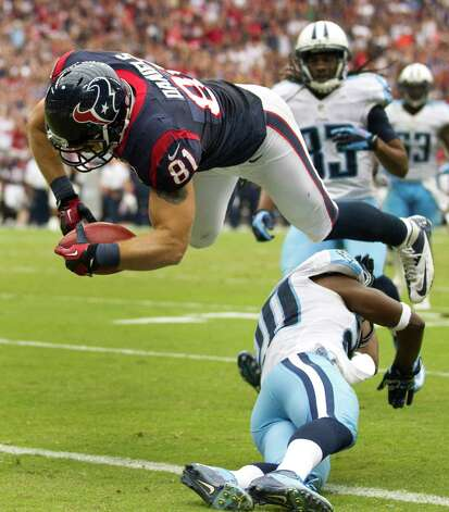 Houston Texans tight end Owen Daniels (81) dives over Tennessee Titans cornerback Alterraun Verner (20) for a 28-yard touchdown reception during the third quarter at Reliant Stadium on Sunday, Sept. 30, 2012, in Houston. The Texans beat the Titans 38-14. Photo: Brett Coomer, Houston Chronicle / © 2012  Houston Chronicle