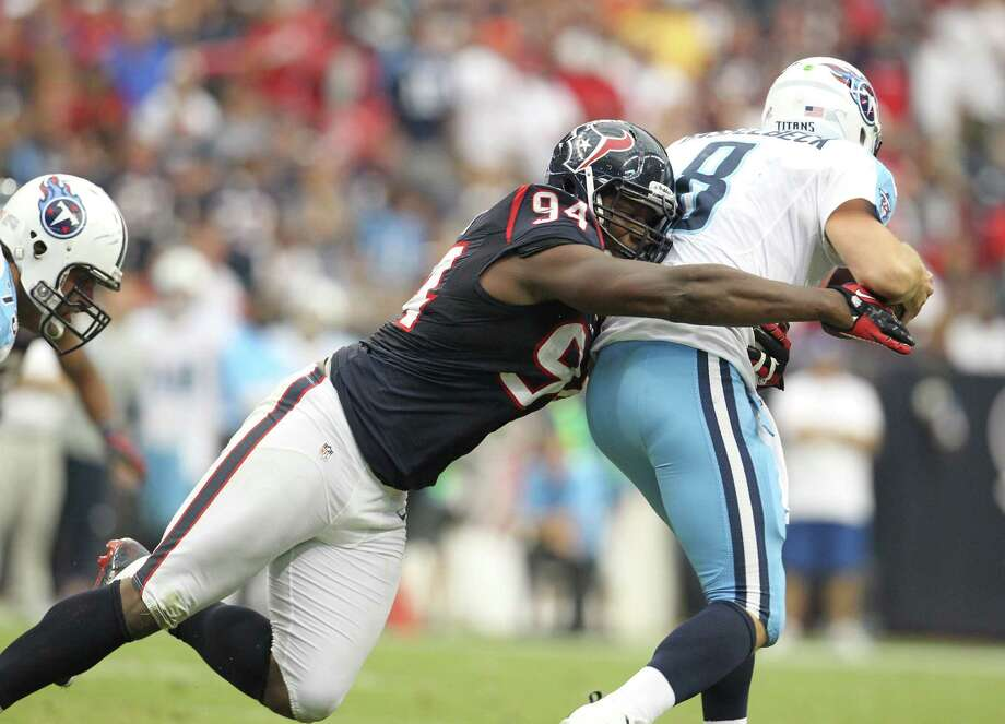 Houston Texans defensive end Antonio Smith (94) sacks Tennessee Titans quarterback Matt Hasselbeck (8) during the fourth quarter at Reliant Stadium on Sunday, Sept. 30, 2012, in Houston. Texans won 38-14. Photo: Karen Warren, Houston Chronicle / © 2012  Houston Chronicle