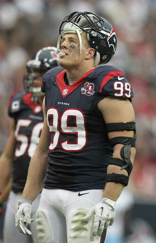 Houston Texans defensive end J.J. Watt (99) during a timeout on the field during the fourth quarter at Reliant Stadium on Sunday, Sept. 30, 2012, in Houston. Texans won 38-14. Photo: Karen Warren, Houston Chronicle / © 2012  Houston Chronicle