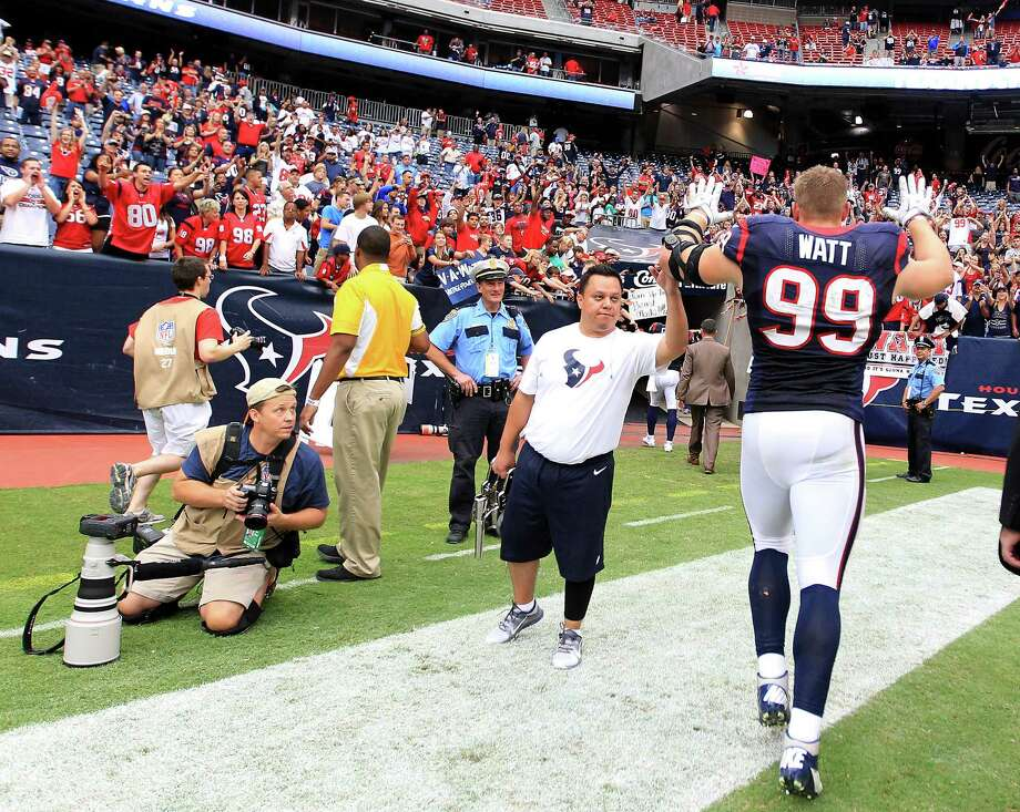 Houston Texans defensive end J.J. Watt (99) comes off the field during the fourth quarter at Reliant Stadium on Sunday, Sept. 30, 2012, in Houston. Texans won 38-14. Photo: Karen Warren, Houston Chronicle / © 2012  Houston Chronicle