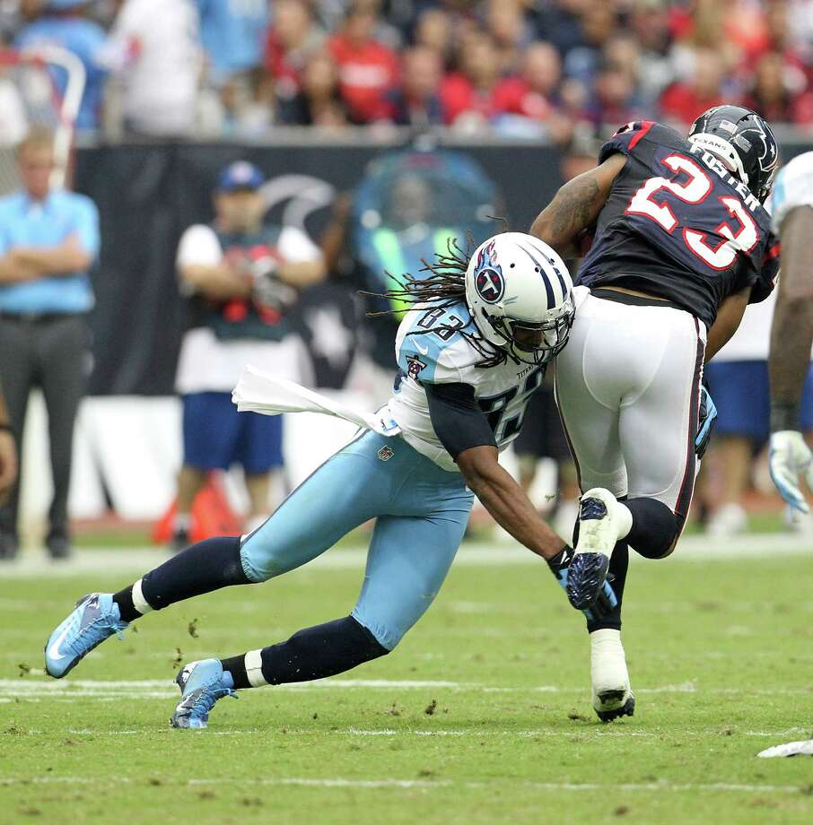 Houston Texans running back Arian Foster (23) tries to get past Tennessee Titans free safety Michael Griffin (33) during the third quarter at Reliant Stadium on Sunday, Sept. 30, 2012, in Houston. Photo: Karen Warren, Houston Chronicle / © 2012  Houston Chronicle