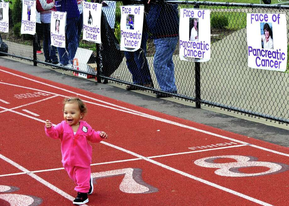 Mckenzie Evans, 1, is one of the younger walkers in the 2012 Pancreatic Cancer Research Walk do at the Bethel High School track Sunday, Sept. 30. Photo: Michael Duffy