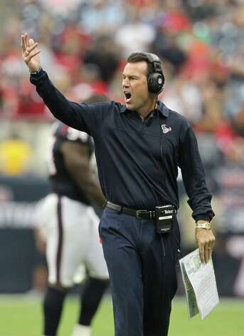 Houston Texans head coach Gary Kubiak signals to talk to a referee as he argues a call during the third quarter at Reliant Stadium on Sunday, Sept. 30, 2012, in Houston. Photo: Karen Warren, Houston Chronicle / © 2012  Houston Chronicle