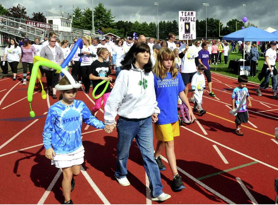 Participants walk in the 2012 Pancreatic Cancer Research Walk at the Bethel High School track Sunday, Sept. 30. Photo: Michael Duffy