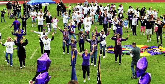 Participants in the 2012 Pancreatic Cancer Research Walk do a zumba warm-up at the Bethel High School track Sunday, Sept. 30. Photo: Michael Duffy