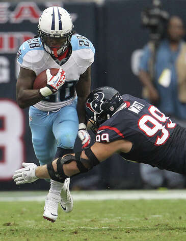 Tennessee Titans running back Chris Johnson (28) tries to get past the tackle of Houston Texans defensive end J.J. Watt (99) during the second quarter at Reliant Stadium on Sunday, Sept. 30, 2012, in Houston. Photo: Karen Warren, Houston Chronicle / © 2012  Houston Chronicle