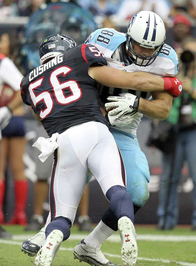 Houston Texans inside linebacker Brian Cushing (56) hits Tennessee Titans tight end Craig Stevens (88) after a midfield catch during the fourth during the second quarter at Reliant Stadium on Sunday, Sept. 30, 2012, in Houston. The Houston Texans won 38-14. Photo: Nick De La Torre, Houston Chronicle / © 2012  Houston Chronicle