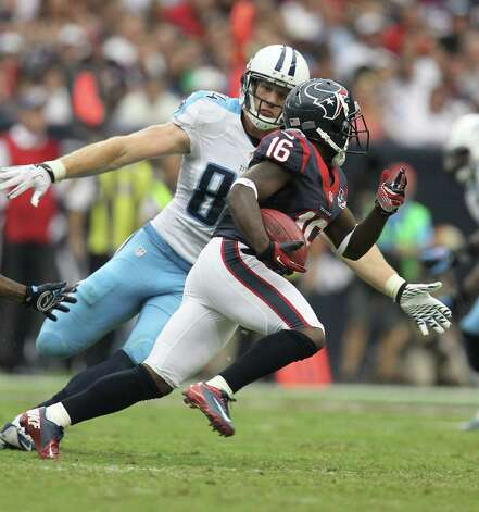 Houston Texans wide receiver Trindon Holliday (16) tries to return the punt against Tennessee Titans tight end Taylor Thompson (84) during the second quarter at Reliant Stadium on Sunday, Sept. 30, 2012, in Houston. Photo: Karen Warren, Houston Chronicle / © 2012  Houston Chronicle
