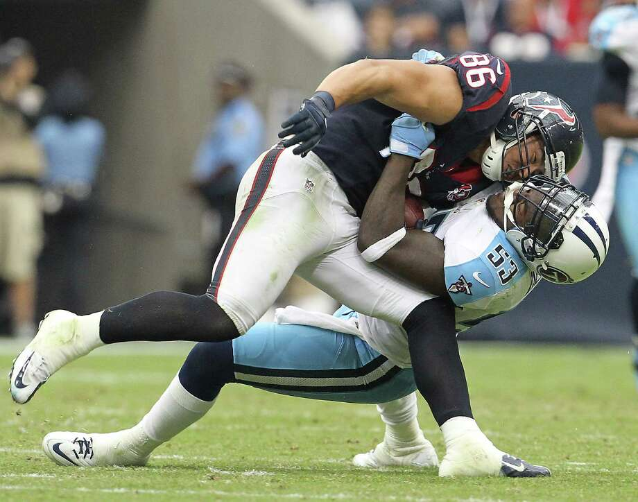 Tennessee Titans linebacker Zac Diles (53) brings down Houston Texans fullback James Casey (86) during the second quarter at Reliant Stadium on Sunday, Sept. 30, 2012, in Houston. Photo: Karen Warren, Houston Chronicle / © 2012  Houston Chronicle